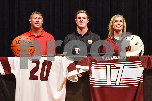 Ron Walls, center and family pose for a photo during signing day at Whitehouse High School in Whitehouse, Texas, on Tuesday, March 21, 2017. Walls will be playing baseball and basketball for Tyler Junior College. (Chelsea Purgahn/Tyler Morning Telegraph)