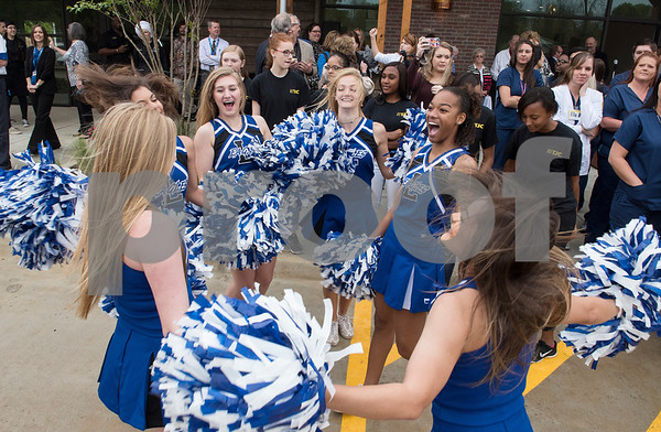 Lindale High School cheerleaders perform during the grand opening of TJC North Campus at The Cannery development in Lindale on Tuesday March 29, 2017. The 8,500 square-foot campus will host general education courses, nursing programs and the school's new veterinary technician program.  (Sarah A. Miller/Tyler Morning Telegraph)