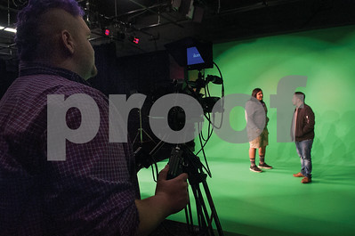 Robert E. Lee High School senior Cole Phillips mans a camera as John Tyler High School juniors Victor Del Angel and David Castilla talk on the green screen during an audio/video production class at the Tyler ISD Career and Technology Center Tuesday Feb. 23, 2016.   (Sarah A. Miller/Tyler Morning Telegraph)