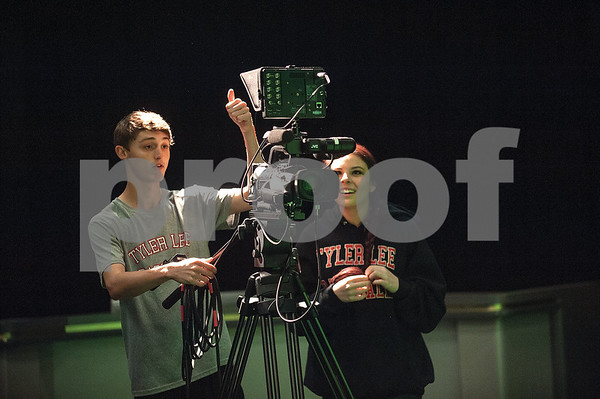 Robert E. Lee High School seniors Luke Hamilton and Kinley Robinson run a camera during an audio/video production class at the Tyler ISD Career and Technology Center Tuesday Feb. 23, 2016.   (Sarah A. Miller/Tyler Morning Telegraph)