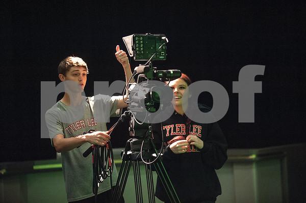 Robert E. Lee High School seniors Luke Hamilton and Kinley Robinson run a camera during an audio/video production class at the Tyler ISD Career and Technology Center Tuesday Feb. 23, 2016.   (Sarah A. Miller/Tyler Morning Telegraph)