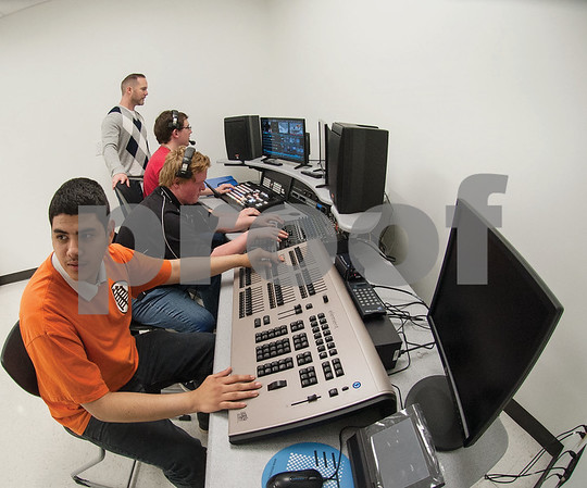 John Tyler High School senior Andrew Pineda runs the lights during an audio/video production class at the Tyler ISD Career and Technology Center Tuesday Feb. 23, 2016.   (Sarah A. Miller/Tyler Morning Telegraph)