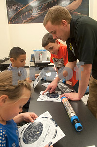 Brian Kremer instructs Isabelle Stanford, 9, of Van, Caleb Hernandez, 8, Edom, and Nathan McLain, 10, of Tyler how to read star and planet locator during Wednesday's session at space camp at the Center for Earth & Space Science on the Tyler Junior College main campus March 9, 2016.  (Sarah A. Miller/Tyler Morning Telegraph)