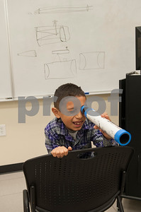 Caleb Hernandez, 8, Edom, looks through a telescope he made during Wednesday's session at space camp at the Center for Earth & Space Science on the Tyler Junior College main campus March 9, 2016.  (Sarah A. Miller/Tyler Morning Telegraph)