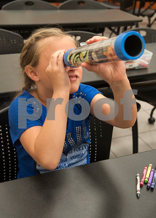 Isabelle Stanford, 9, of Van, looks through a telescope she made during Wednesday's session at space camp at the Center for Earth & Space Science on the Tyler Junior College main campus March 9, 2016.  (Sarah A. Miller/Tyler Morning Telegraph)