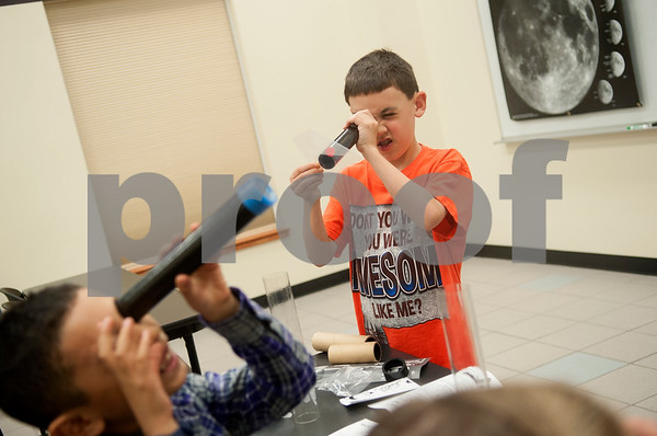 Caleb Hernandez, 8, Edom, and Nathan McLain, 10, of Tyler, use telescopes they made during Wednesday's session at space camp at the Center for Earth & Space Science on the Tyler Junior College main campus March 9, 2016.  (Sarah A. Miller/Tyler Morning Telegraph)