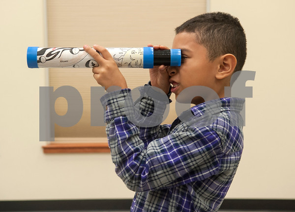 Caleb Hernandez, 8, Edom, tries out a telescope he made during Wednesday's session at space camp at the Center for Earth & Space Science on the Tyler Junior College main campus March 9, 2016.  (Sarah A. Miller/Tyler Morning Telegraph)