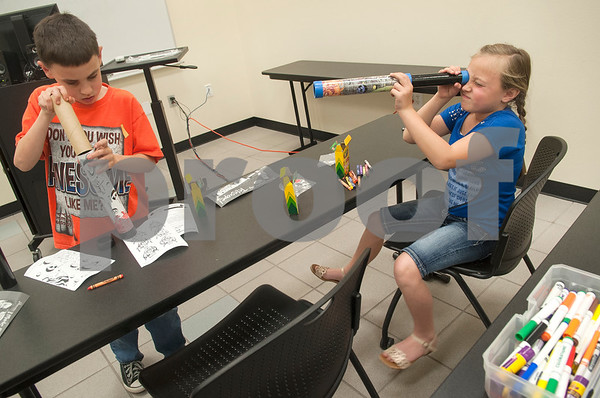 Nathan McLain, 10, of Tyler and Isabelle Stanford, 9, of Van,  play with telescopes they made during Wednesday's session at space camp at the Center for Earth & Space Science on the Tyler Junior College main campus March 9, 2016.  (Sarah A. Miller/Tyler Morning Telegraph)
