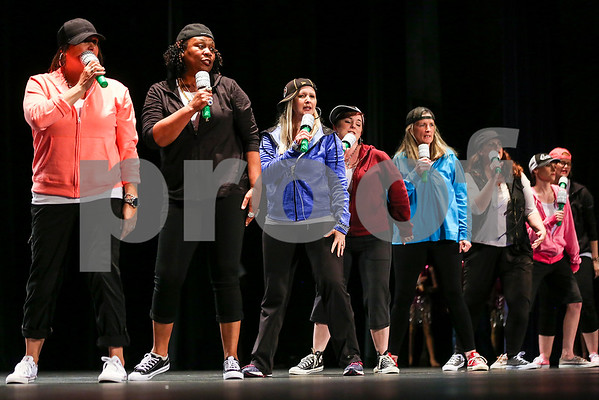 "Teachers perform during the Caldwell Dance Showcase at Caldwell Auditorium in Tyler, Texas, on Thursday, March 9, 2017. Over 600 elementary students, their teachers and a few surprise guests performed during the program, which was themed ""In The News."" (Chelsea Purgahn/Tyler Morning Telegraph)"