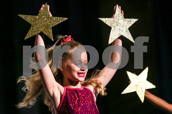 "A student performs ""Make Me A Star"" during the Caldwell Dance Showcase at Caldwell Auditorium in Tyler, Texas, on Thursday, March 9, 2017. Over 600 elementary students, their teachers and a few surprise guests performed during the program, which was themed ""In The News."" (Chelsea Purgahn/Tyler Morning Telegraph)"