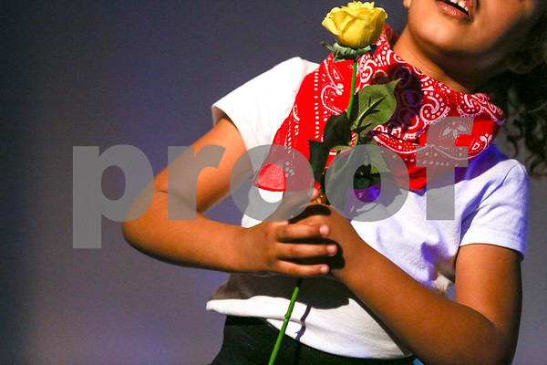 "A student performs ""Yellow Rose of Tyler"" during the Caldwell Dance Showcase at Caldwell Auditorium in Tyler, Texas, on Thursday, March 9, 2017. Over 600 elementary students, their teachers and a few surprise guests performed during the program, which was themed ""In The News."" (Chelsea Purgahn/Tyler Morning Telegraph)"