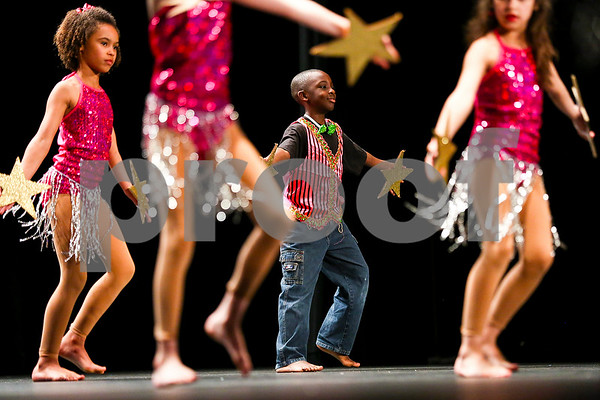 "Students perform ""Make Me A Star"" during the Caldwell Dance Showcase at Caldwell Auditorium in Tyler, Texas, on Thursday, March 9, 2017. Over 600 elementary students, their teachers and a few surprise guests performed during the program, which was themed ""In The News."" (Chelsea Purgahn/Tyler Morning Telegraph)"