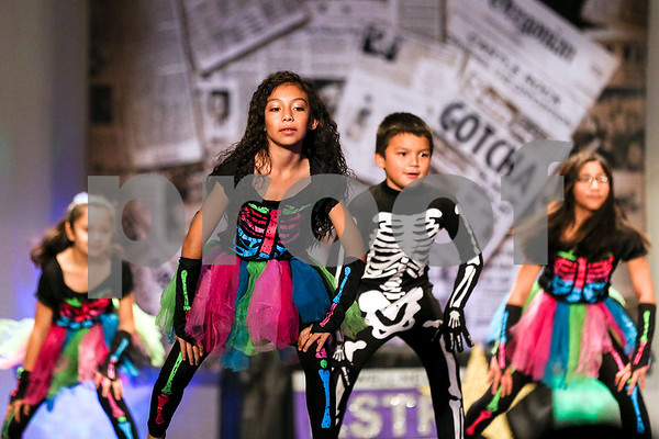"Students perform ""Bones"" during the Caldwell Dance Showcase at Caldwell Auditorium in Tyler, Texas, on Thursday, March 9, 2017. Over 600 elementary students, their teachers and a few surprise guests performed during the program, which was themed ""In The News."" (Chelsea Purgahn/Tyler Morning Telegraph)"