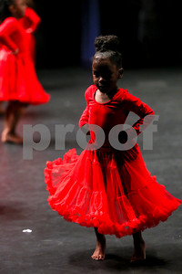 "A student performs ""Rose Festival Ball"" during the Caldwell Dance Showcase at Caldwell Auditorium in Tyler, Texas, on Thursday, March 9, 2017. Over 600 elementary students, their teachers and a few surprise guests performed during the program, which was themed ""In The News."" (Chelsea Purgahn/Tyler Morning Telegraph)"