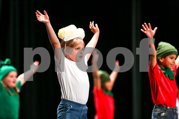 "Students perform ""Veggie Power"" during the Caldwell Dance Showcase at Caldwell Auditorium in Tyler, Texas, on Thursday, March 9, 2017. Over 600 elementary students, their teachers and a few surprise guests performed during the program, which was themed ""In The News."" (Chelsea Purgahn/Tyler Morning Telegraph)"