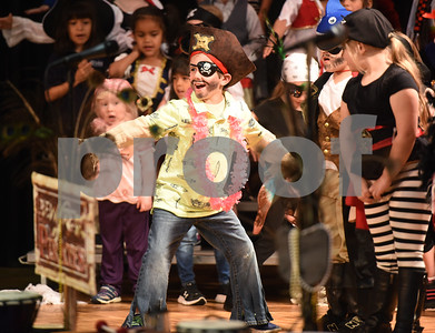 All Saints Episcopal School student Nash Jones, 5, acts as a surfer interrupting a pirate during a pirate musical held Thursday morning at the Lower School Auditorium.   (Sarah A. Miller/Tyler Morning Telegraph)