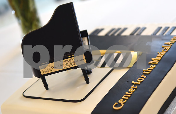 A piano themed cake is displayed at The University of Texas at Tyler for the grand opening of the Center for the Musical Arts, a $6.5 million two-story addition that houses band/orchestra and choir practice rooms, teaching studios and faculty offices at the University of Texas at Tyler.  (Sarah A. Miller/Tyler Morning Telegraph)