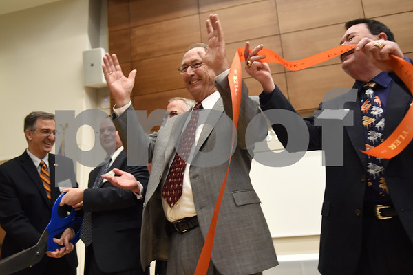 The University of Texas at Tyler President Dr. Rodney Mabry, center, celebrates at the ribbon cutting at the grand opening of the Center for the Musical Arts, a $6.5 million two-story addition that houses band/orchestra and choir practice rooms, teaching studios and faculty offices at the University of Texas at Tyler.  (Sarah A. Miller/Tyler Morning Telegraph)
