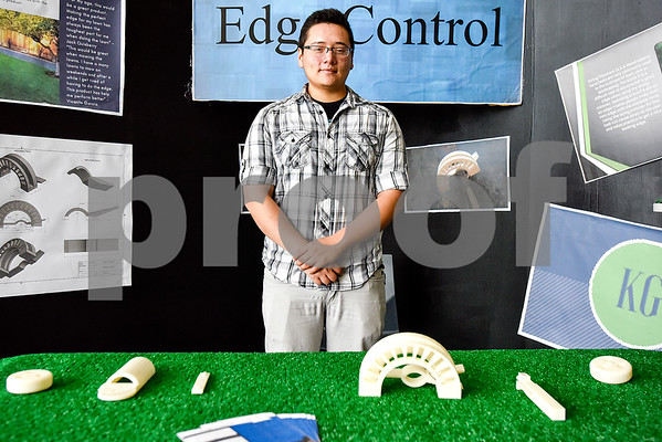 John Tyler student Kevin Gomez, 18, poses for a photo at his product booth at the Tyler ISD Career And Technology Center in Tyler, Texas, on Thursday, April 13, 2017. The center hosted its first Trades Show, which showcased senior projects from engineering, design and development, auto collision repair, architectural design, construction, marketing and more. (Chelsea Purgahn/Tyler Morning Telegraph)