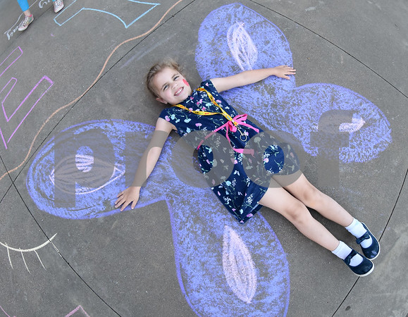 Olivia Thompson, 5, poses as a chalk art butterfly during the annual Art Gallery Walk at Bell Elementary School in Tyler Thursday. It was the 10th year for the event which features a piece of artwork from every student in the school.  (Sarah A. Miller/Tyler Morning Telegraph)