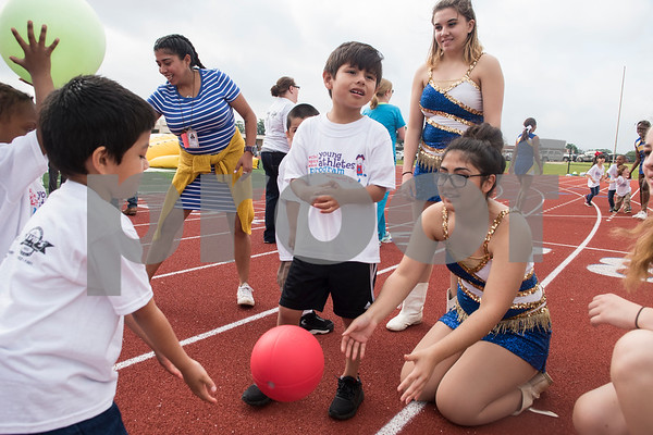 Jacksonville High School majorettes play games with students during a Special Olympics Young Athletes event at Howard Cook Field in Jacksonville Friday April 21, 2017.    (Sarah A. Miller/Tyler Morning Telegraph)
