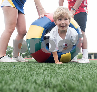 Rhett Stinson, 6, crawls through an obstacle during a Special Olympics Young Athletes event at Howard Cook Field in Jacksonville Friday April 21, 2017.    (Sarah A. Miller/Tyler Morning Telegraph)