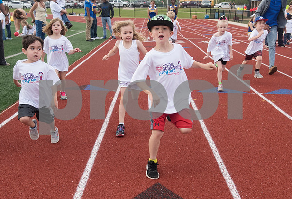 Children competes in a foot race during a Special Olympics Young Athletes event at Howard Cook Field in Jacksonville Friday April 21, 2017.    (Sarah A. Miller/Tyler Morning Telegraph)