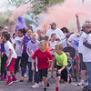 As colored powder erupts, participants set off in the Alexandria My School Color Run on Saturday.
