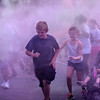 Alexandria My School Color Run participants charge through a haze of powder on Saturday.