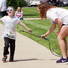 Mark Maynard | For The Herald Bulletin<br /> Marley Jenkins gets a spray of color from Lindsie Chaplin during the Alexandria My School Color Run.