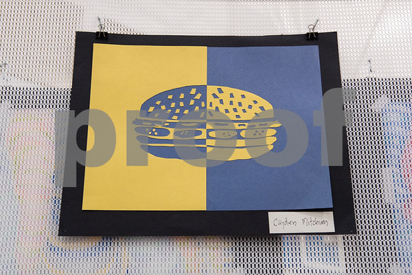 Artwork of a cheeseburger is pictured in the All Saints Episcopal School Student Art Exhibit Monday April 24, 2017. The art exhibit features pieces from all students grade 3K-12. It opens Tuesday at 6:30 p.m. at Brookshire Gym.  (Sarah A. Miller/Tyler Morning Telegraph)