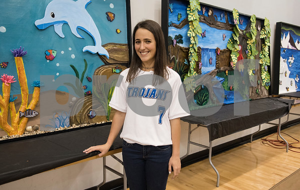Upper School Art Club president junior Elizabeth Schoenbrunm 17, stands by the murals her club made that will be on display for the All Saints Episcopal School Student Art Exhibit Monday April 24, 2017. The art exhibit features pieces from all students grade 3K-12. It opens Tuesday at 6:30 p.m. at Brookshire Gym.  (Sarah A. Miller/Tyler Morning Telegraph)