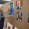 All Saints Episcopal middle school art teacher Linda Wheat hangs sets up for the Student Art Exhibit Monday April 24, 2017. The art exhibit features pieces from all students grade 3K-12. It opens Tuesday at 6:30 p.m. at Brookshire Gym.<br /> <br /> (Sarah A. Miller/Tyler Morning Telegraph)