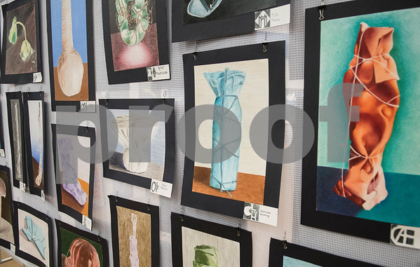 Artwork of wrapped household items are pictured in the All Saints Episcopal School Student Art Exhibit Monday April 24, 2017. The art exhibit features pieces from all students grade 3K-12. It opens Tuesday at 6:30 p.m. at Brookshire Gym.  (Sarah A. Miller/Tyler Morning Telegraph)