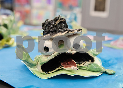 A clay frog made by All Saints Episcopal Students is on display in the Student Art Exhibit Monday April 24, 2017. The art exhibit features pieces from all students grade 3K-12. It opens Tuesday at 6:30 p.m. at Brookshire Gym.  (Sarah A. Miller/Tyler Morning Telegraph)