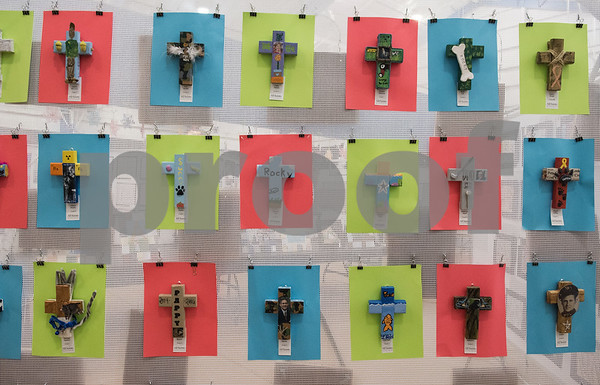 Decorated crosses made by students hang on a wall on display for the All Saints Episcopal School Student Art Exhibit Monday April 24, 2017. The art exhibit features pieces from all students grade 3K-12. It opens Tuesday at 6:30 p.m. at Brookshire Gym.  (Sarah A. Miller/Tyler Morning Telegraph)