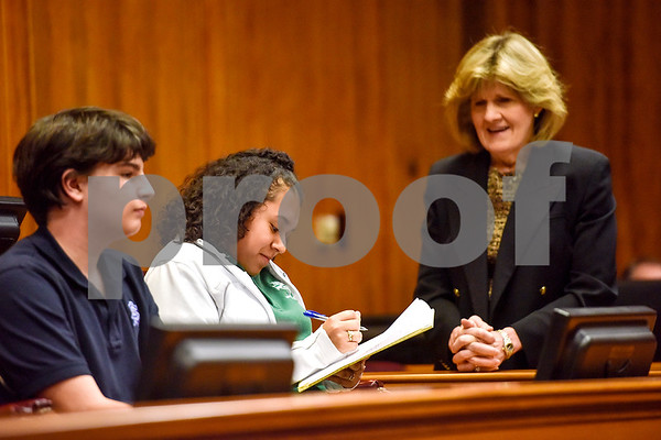 Assistant U.S. attorney Ruth Yeager, right, watches as a Bishop Thomas K. Gorman Regional Catholic School student signs a paper during a mock trial at the William M. Steger Federal Building and U.S. Courthouse in Tyler, Texas, on Monday, April 24, 2017. Students from Bishop Thomas K. Gorman Regional Catholic School and All Saints Episcopal School were touring the building and surprised with the opportunity to participate in a mock trial. (Chelsea Purgahn/Tyler Morning Telegraph)