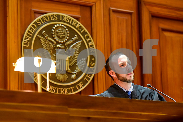 Assistant U.S. attorney Ryan Locker listens during a mock trial at the William M. Steger Federal Building and U.S. Courthouse in Tyler, Texas, on Monday, April 24, 2017. Students from Bishop Thomas K. Gorman Regional Catholic School and All Saints Episcopal School were touring the building and surprised with the opportunity to participate in a mock trial. (Chelsea Purgahn/Tyler Morning Telegraph)