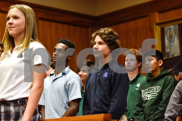 Bishop Thomas K. Gorman Regional Catholic School and All Saints Episcopal School students stand and listen during a mock trial at the William M. Steger Federal Building and U.S. Courthouse in Tyler, Texas, on Monday, April 24, 2017. Students from Bishop Thomas K. Gorman Regional Catholic School and All Saints Episcopal School were touring the building and surprised with the opportunity to participate in a mock trial. (Chelsea Purgahn/Tyler Morning Telegraph)