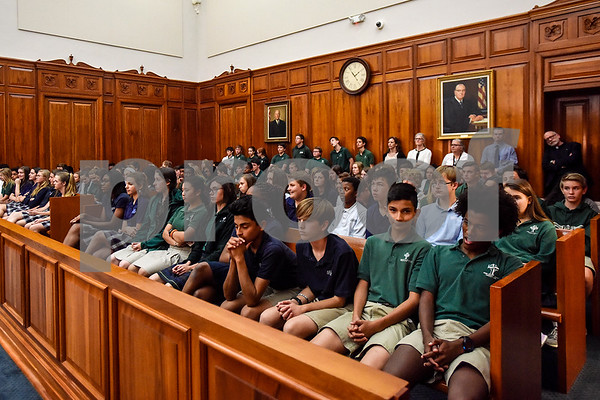 Bishop Thomas K. Gorman Regional Catholic School and All Saints Episcopal School students listen during a mock trial at the William M. Steger Federal Building and U.S. Courthouse in Tyler, Texas, on Monday, April 24, 2017. Students from Bishop Thomas K. Gorman Regional Catholic School and All Saints Episcopal School were touring the building and surprised with the opportunity to participate in a mock trial. (Chelsea Purgahn/Tyler Morning Telegraph)