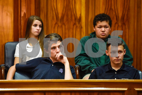Bishop Thomas K. Gorman Regional Catholic School and All Saints Episcopal School students sit as jury members during a mock trial at the William M. Steger Federal Building and U.S. Courthouse in Tyler, Texas, on Monday, April 24, 2017. Students from Bishop Thomas K. Gorman Regional Catholic School and All Saints Episcopal School were touring the building and surprised with the opportunity to participate in a mock trial. (Chelsea Purgahn/Tyler Morning Telegraph)