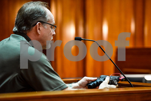 Deputy U.S. Marshall John Garrison examines a piece of evidence during a mock trial at the William M. Steger Federal Building and U.S. Courthouse in Tyler, Texas, on Monday, April 24, 2017. Students from Bishop Thomas K. Gorman Regional Catholic School and All Saints Episcopal School were touring the building and surprised with the opportunity to participate in a mock trial. (Chelsea Purgahn/Tyler Morning Telegraph)