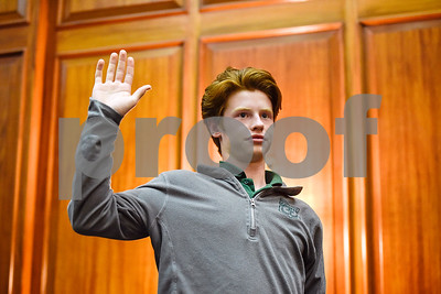 Bishop Thomas K. Gorman Regional Catholic School student Brendan Egan is sworn in during a mock trial at the William M. Steger Federal Building and U.S. Courthouse in Tyler, Texas, on Monday, April 24, 2017. Students from Bishop Thomas K. Gorman Regional Catholic School and All Saints Episcopal School were touring the building and surprised with the opportunity to participate in a mock trial. (Chelsea Purgahn/Tyler Morning Telegraph)