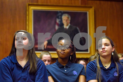 All Saints Episcopal School students listen during a mock trial at the William M. Steger Federal Building and U.S. Courthouse in Tyler, Texas, on Monday, April 24, 2017. Students from Bishop Thomas K. Gorman Regional Catholic School and All Saints Episcopal School were touring the building and surprised with the opportunity to participate in a mock trial. (Chelsea Purgahn/Tyler Morning Telegraph)