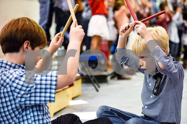 "All Saints Episcopal School students participate in ""A History of Texas Cowboy Music"" at the school in Tyler, Texas, on Tuesday, April 25, 2017. Seventy-five third and fourth graders sang, danced and played various instruments during the performance for students and parents. (Chelsea Purgahn/Tyler Morning Telegraph)"
