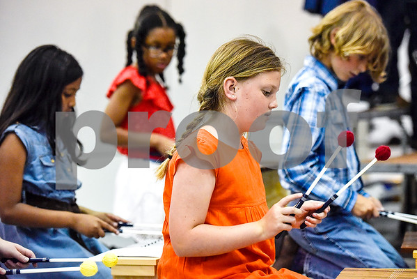 """All Saints Episcopal School students participate in """"A History of Texas Cowboy Music"""" at the school in Tyler, Texas, on Tuesday, April 25, 2017. Seventy-five third and fourth graders sang, danced and played various instruments during the performance for students and parents. (Chelsea Purgahn/Tyler Morning Telegraph)"""