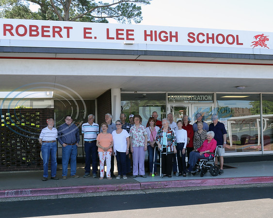 The first graduating class of Robert E. Lee High School Class gather for a group photo in front of their high schoo on Saturday, April 27,  2019 in Tyler, Tx.  The school is scheduled to be torn down next year. (Rick Flack/Freelance)