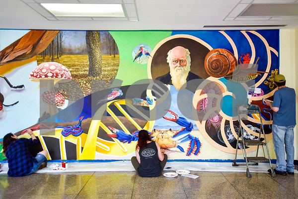 Art students Lauren Pitre, Keri Fidone and Sam Edwards work on a mural at the Biology, Education and Psychology building at The University of Texas at Tyler in Tyler, Texas, on Friday, April 28, 2017. The students started planning the mural in January and painting in February. (Chelsea Purgahn/Tyler Morning Telegraph)