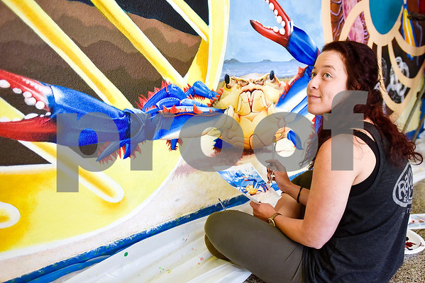 Art student Keri Fidone works on a mural at the Biology, Education and Psychology building at The University of Texas at Tyler in Tyler, Texas, on Friday, April 28, 2017. The students started planning the mural in January and painting in February. (Chelsea Purgahn/Tyler Morning Telegraph)