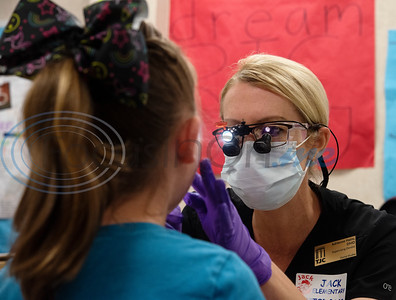 Tyler Junior College supervising dentist Adrienne Haire gives preventative dental care to first grader Annalee Sikes, 7, at Jack Elementary School on Monday April 29, 2019.  (Sarah A. Miller/Tyler Morning Telegraph)